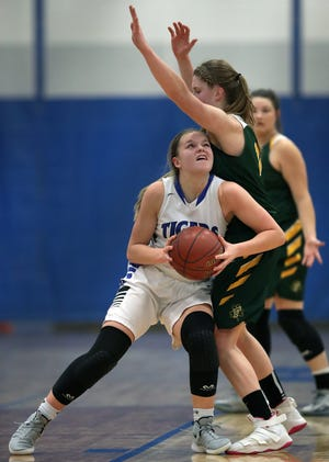 Wrightstown's Ella Diny battles against Freedom's Karissa Wurster in a game last season. The teams battle each other Thursday for North Eastern Conference supremacy.