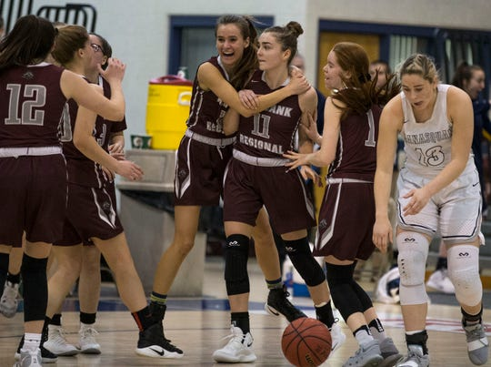 Shore Conference Tournament quarterfinals featuring Manasquan vs Red Bank Regional. Red Bank Regional's Meghan Murray (11) is congratulated by teammates after scoring with 4 seconds left in the game to send it to overtime.Toms River, NJSaturday, February 16, 2019