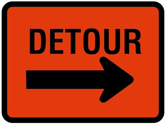 A detour road sign.