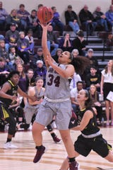 McMurry's Skyler Reyna (34) takes a layup against Hardin-Simmons at Kimbrell Arena on Saturday, Feb. 16, 2019. Reyna had 16 points and 16 rebounds in the 69-66 loss.