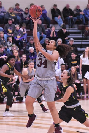 McMurry's Skyler Reyna (34) takes a layup against Hardin-Simmons on Feb. 16 at Kimbrell Arena. Reyna had 16 points and 16 rebounds in the 69-66 loss.
