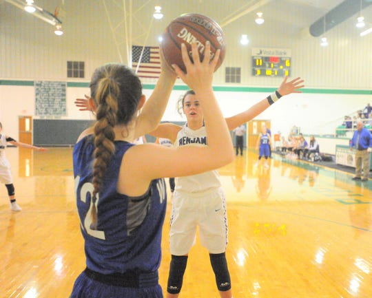 Benjamin sophomore Macy Flowers, background, pressures the inbound pass of Westbrook's Hadley Redwine during an area playoff game Friday, Feb. 15, 2019, at Piper Court in Hamlin.