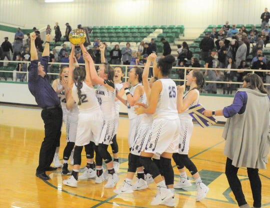 Benjamin girls basketball coach Cody Propps, left, raises two fists in celebration of the Lady Mustangs' 51-45 area playoff win over Westbrook on Friday, Feb. 15, 2019, at Piper Court in Hamlin.