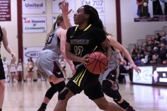 HSU guard Taylor Gaffney (10) drives into the lane against McMurry at Kimbrell Arena on Saturday, Feb. 16, 2019.