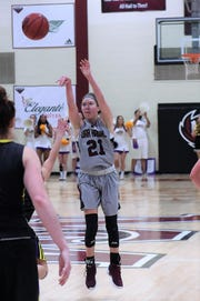 McMurry's London Weilert (21) takes a 3-point shot against Hardin-Simmons at Kimbrell Arena on Saturday, Feb. 16, 2019. Weilert scored 15 points in the 69-66 loss.