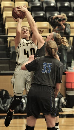 Decatur's Mackenzie Whitaker, center, blocks a shot by Big Spring's Ryen Terrazas (40) while Katie Hale (35) looks on. Decatur won the Region I-4A area playoff game 46-30 on Friday, Feb. 15, 2019, in Clyde.