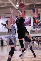 HSU's Kaitlyn Ellis (21) puts up a shot around a McMurry defender at Kimbrell Arena on Saturday, Feb. 16, 2019. Ellis finished with a game-high 17 points in the 69-66 win.