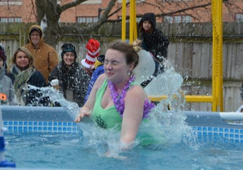 Members of the Kellogg Community College Police Academy dive in at the 2019 Area 16 Polar Plunge in Kalamazoo.
