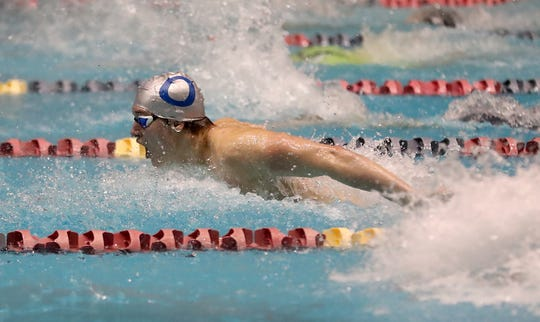 Olympic's Haakon Meyer swims the 200 IM at the state swim meet in Federal Way on Saturday, February 16, 2019.
