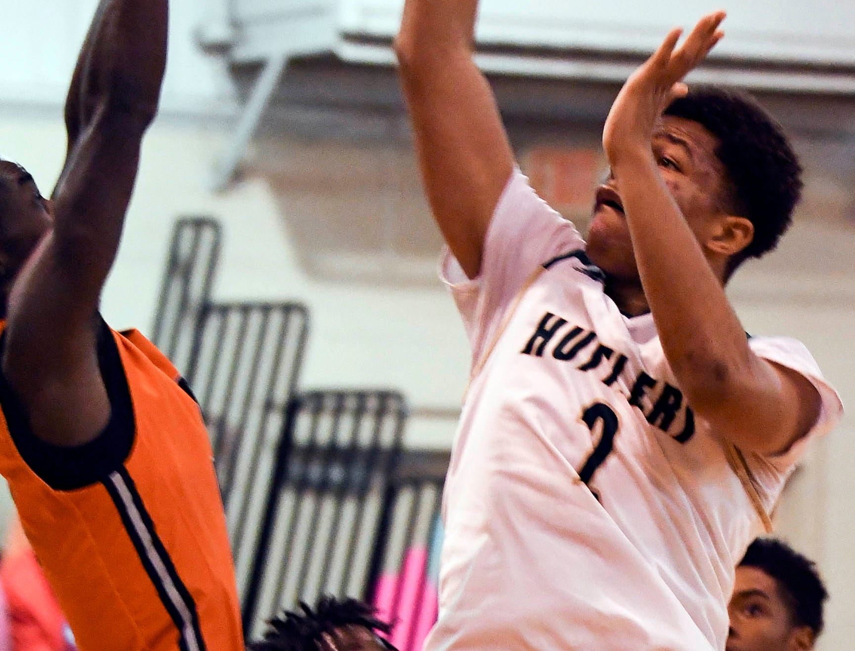 MCC's CJ Livingston takes a shot over the defense of Samarion Bryant of Cocoa during Friday's District 7-5A boys basketball championship game at Holy Trinity in Melbourne