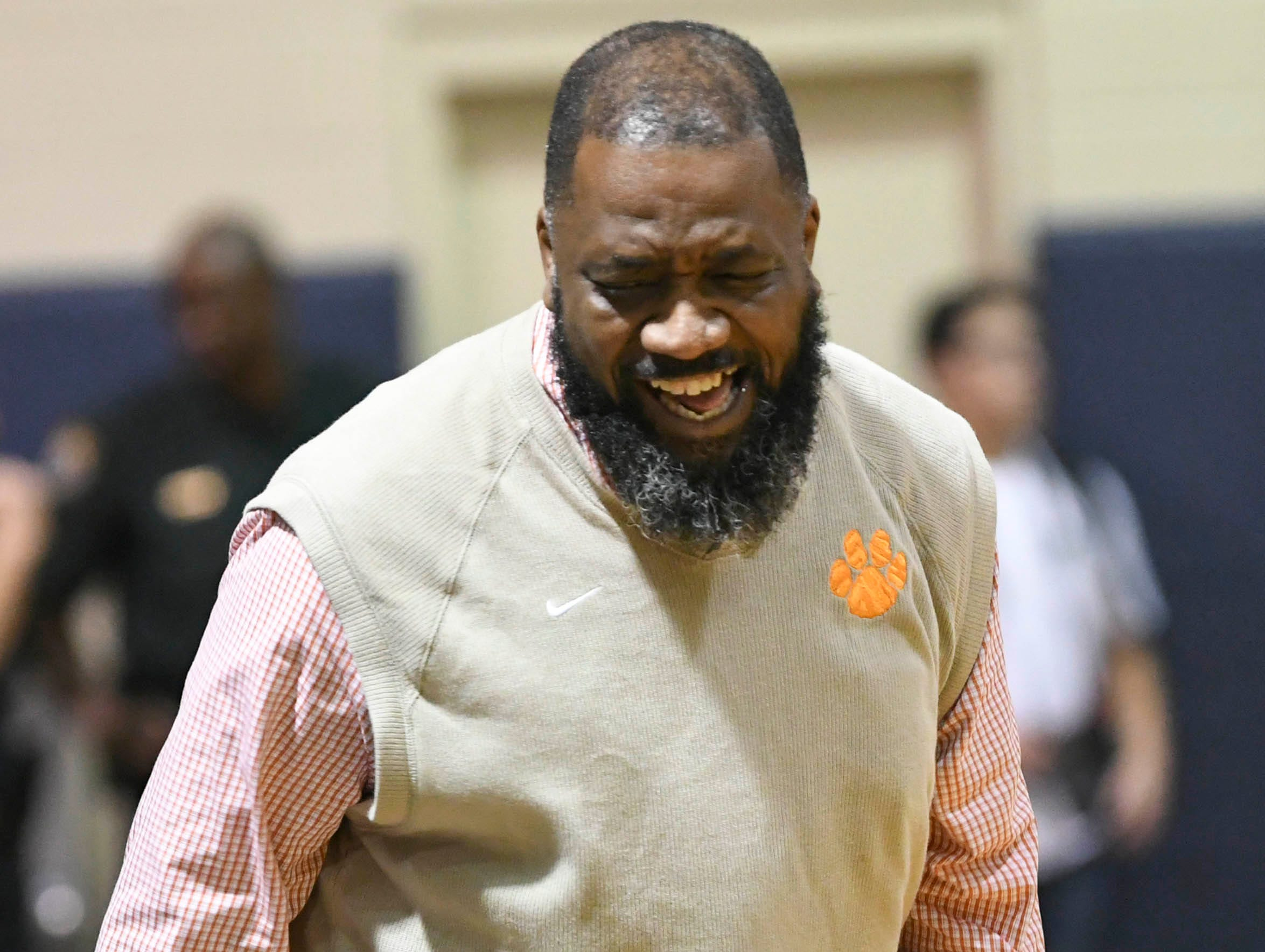 Cocoa boys basketball head coach Edwin Jones reacts to a call during Friday's District 7-5A boys basketball championship game at Holy Trinity in Melbourne