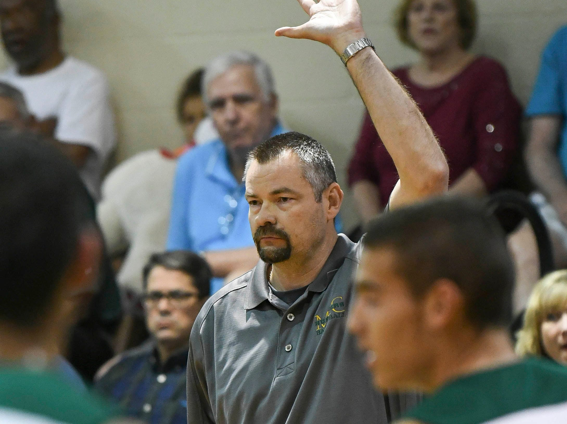 MCC basketball head coach Brett Terry watches his players during the District 7-5A boys basketball championship game at Holy Trinity in Melbourne