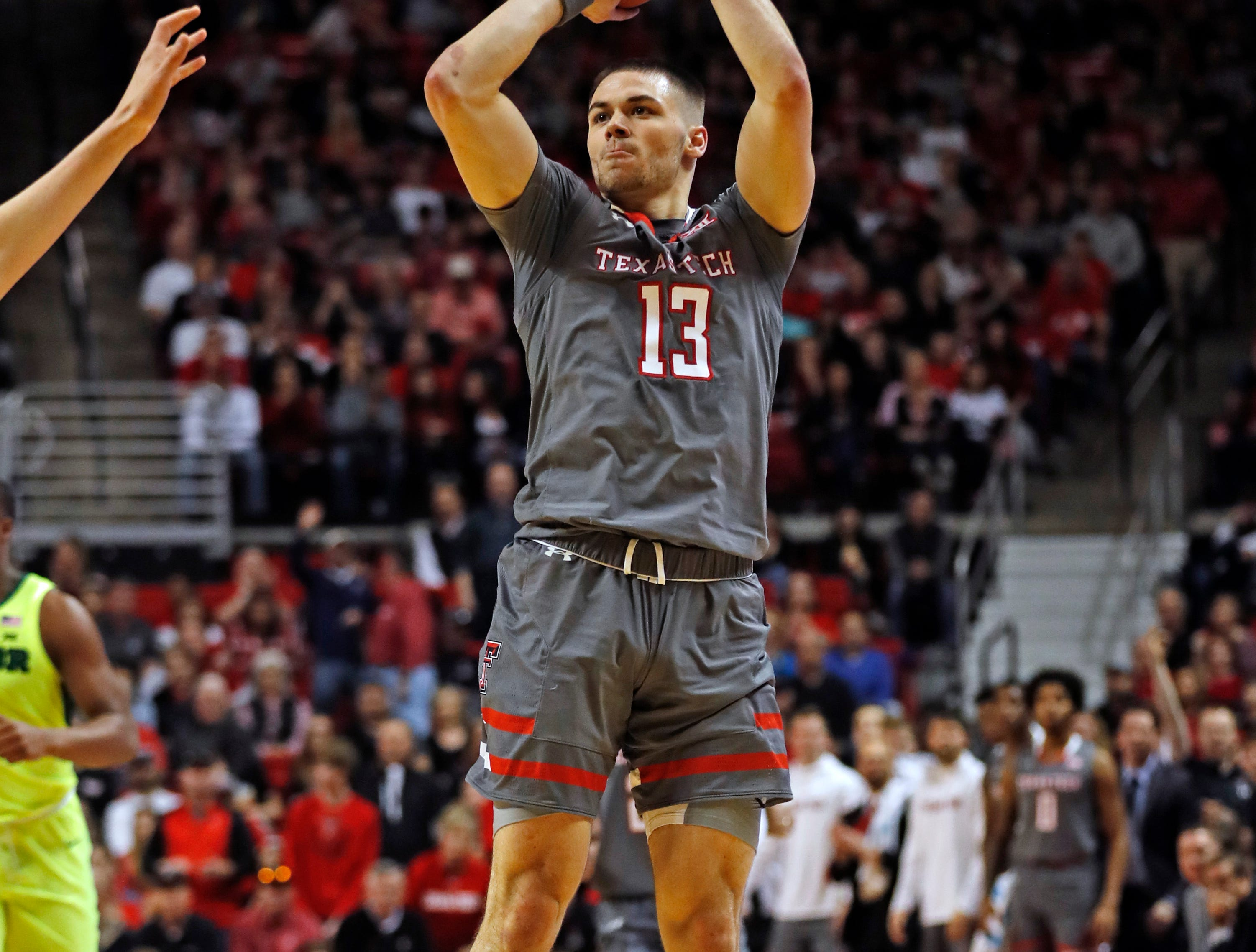 Texas Tech's Matt Mooney (13) shoots the ball for three points during the first half of an NCAA college basketball game against Baylor, Saturday, Feb. 16, 2019, in Lubbock, Texas. (AP Photo/Brad Tollefson)