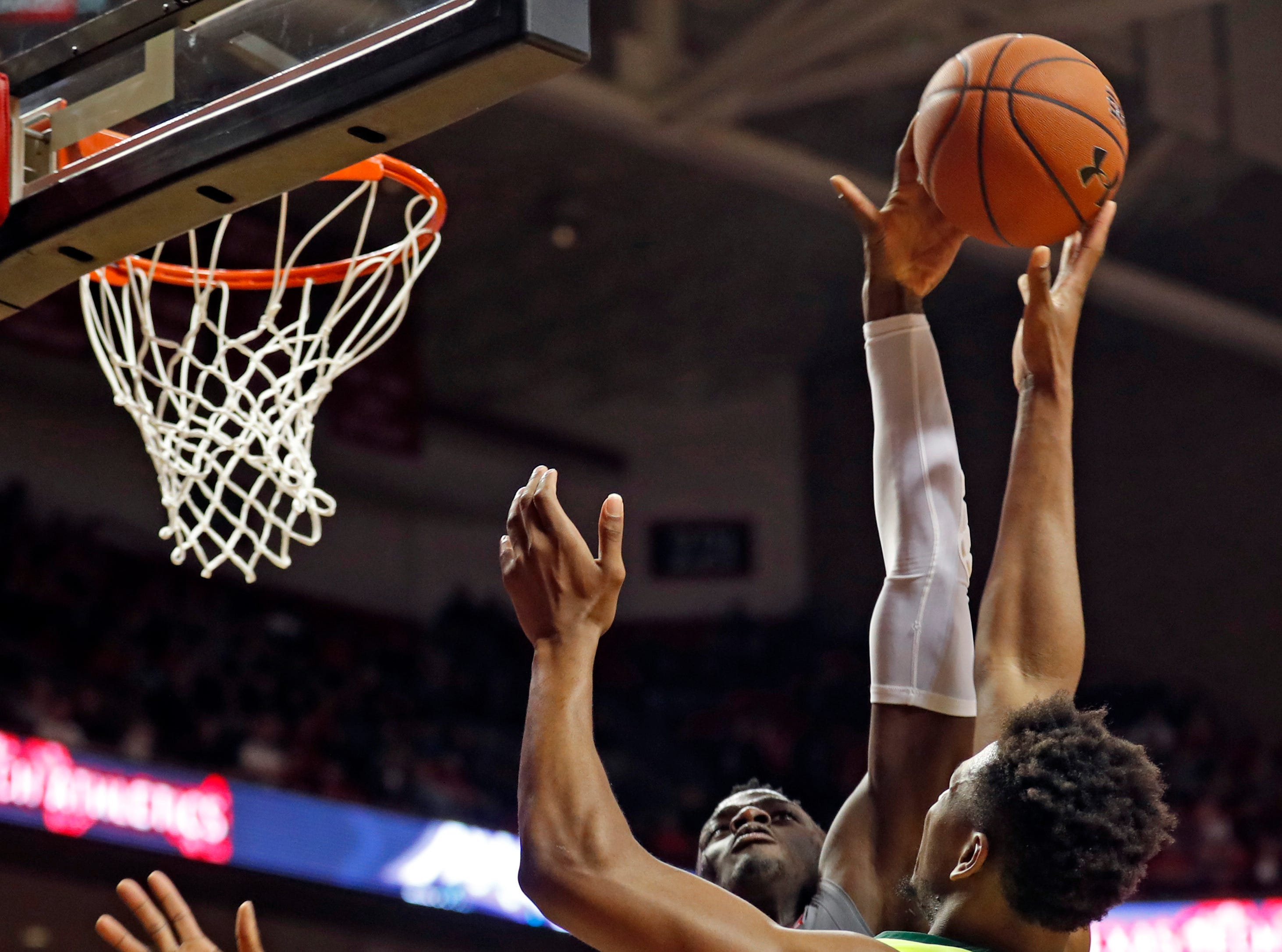 Texas Tech's Norense Odiase (32) blocks the shot by Baylor's Flo Thamba (0)  during the first half of an NCAA college basketball game Saturday, Feb. 16, 2019, in Lubbock, Texas. (AP Photo/Brad Tollefson)