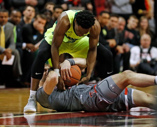 Baylor's Devonte Bandoo (2) tries to steal the ball from Texas Tech's Matt Mooney (13) during the first half of an NCAA college basketball game Saturday, Feb. 16, 2019, in Lubbock, Texas. (AP Photo/Brad Tollefson)