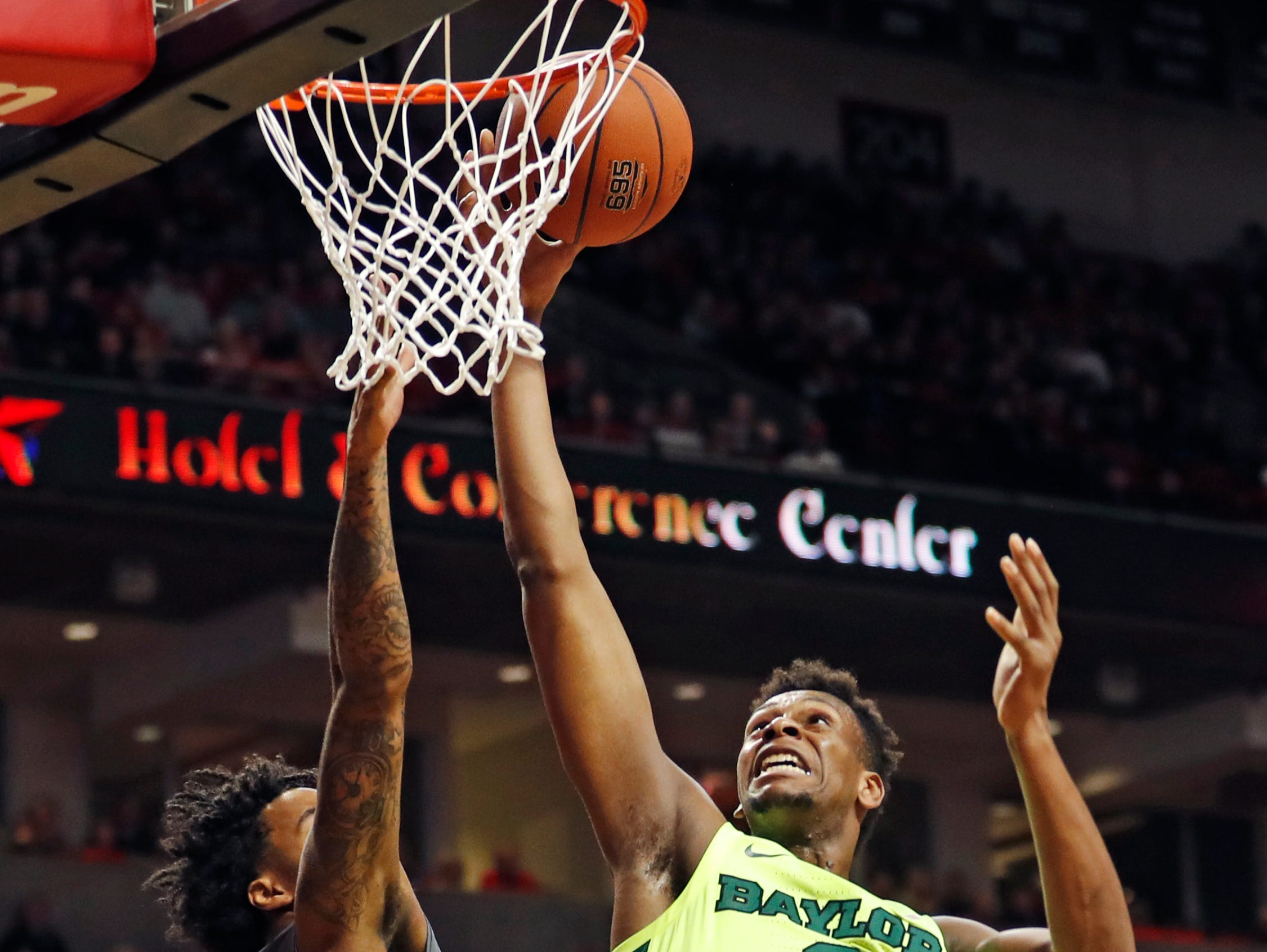 Texas Tech's Kyler Edwards (0) blocks a shot by Baylor's Flo Thamba (0) during the second half of an NCAA college basketball game Saturday, Feb. 16, 2019, in Lubbock, Texas. (AP Photo/Brad Tollefson)