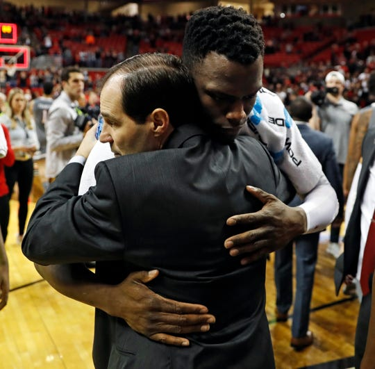 Baylor coach Scott Drew hugs Texas Tech's Norense Odiase (32) as he walks off the court during the second half of an NCAA college basketball game against Baylor, Saturday, Feb. 16, 2019, in Lubbock, Texas. Two of Odiase's cousins died in a car accident Friday morning. (AP Photo/Brad Tollefson)