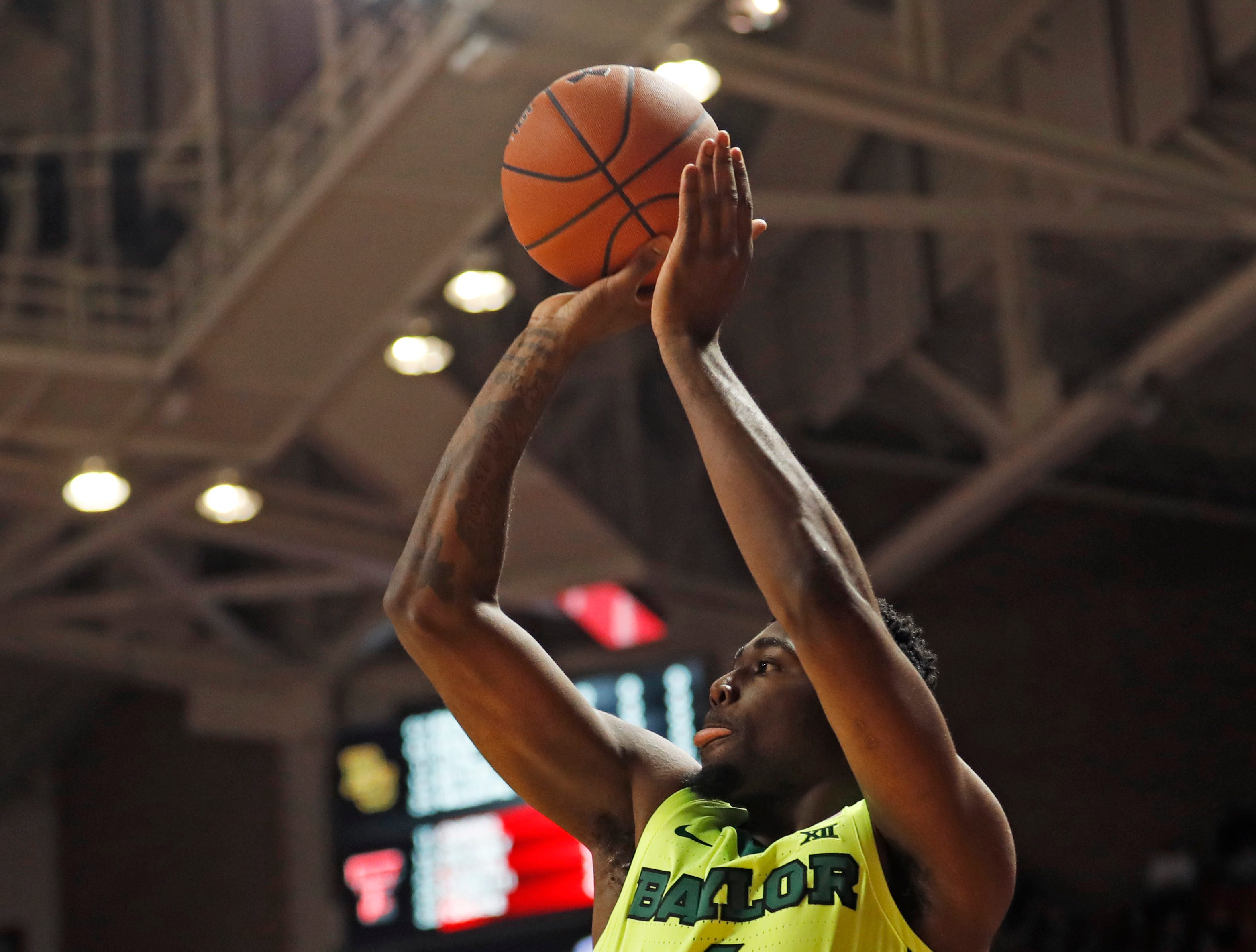 Baylor's Mario Kegler (4) shoots the ball for three points during the first half of an NCAA college basketball game against Texas Tech, Saturday, Feb. 16, 2019, in Lubbock, Texas. (AP Photo/Brad Tollefson)