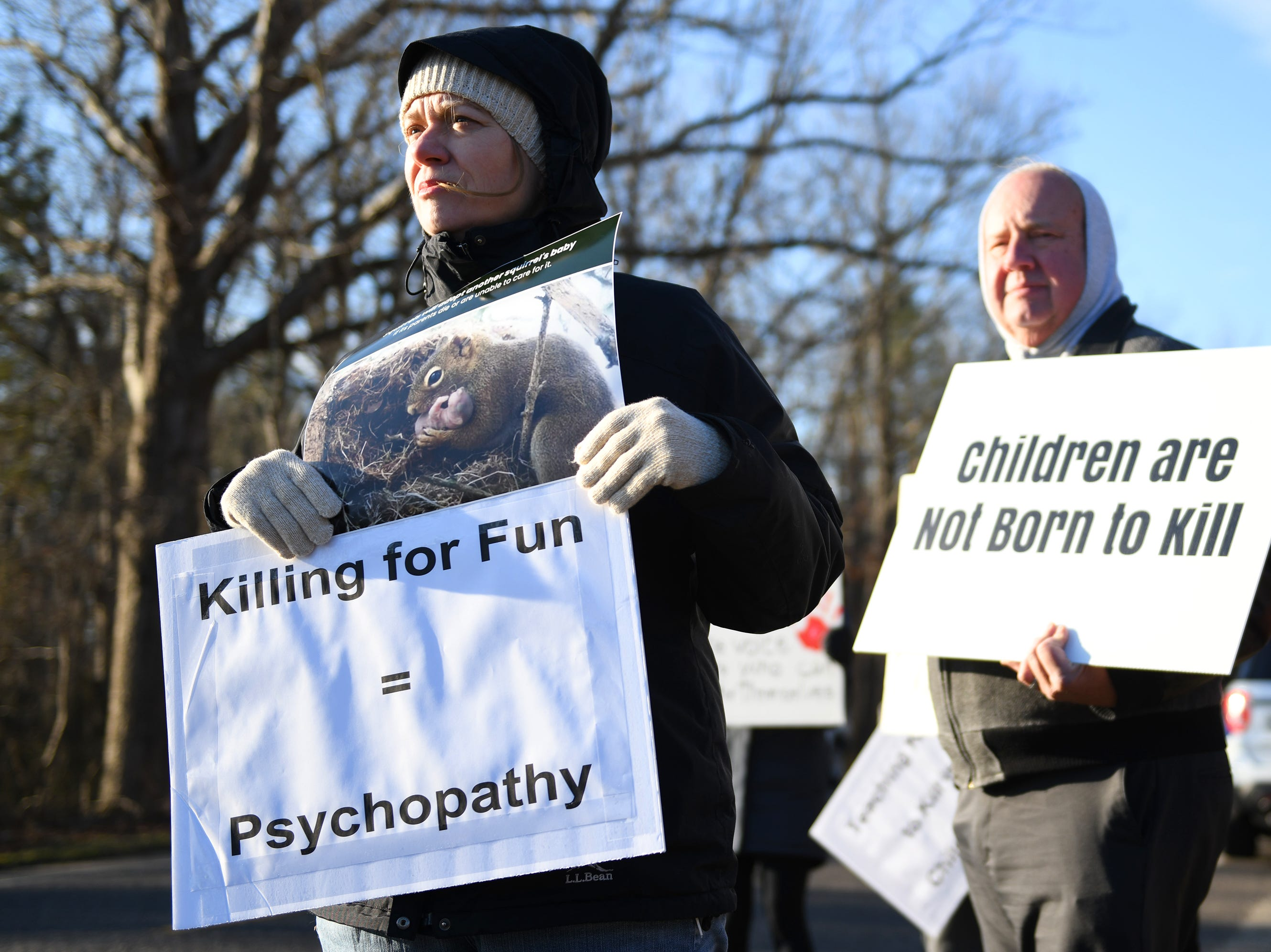 Animal rights activists protest the First Annual Family Squirrel Classic hosted by the Inskip Antler Hunting Club in Winslow Township on Saturday, Feb. 16, 2019.