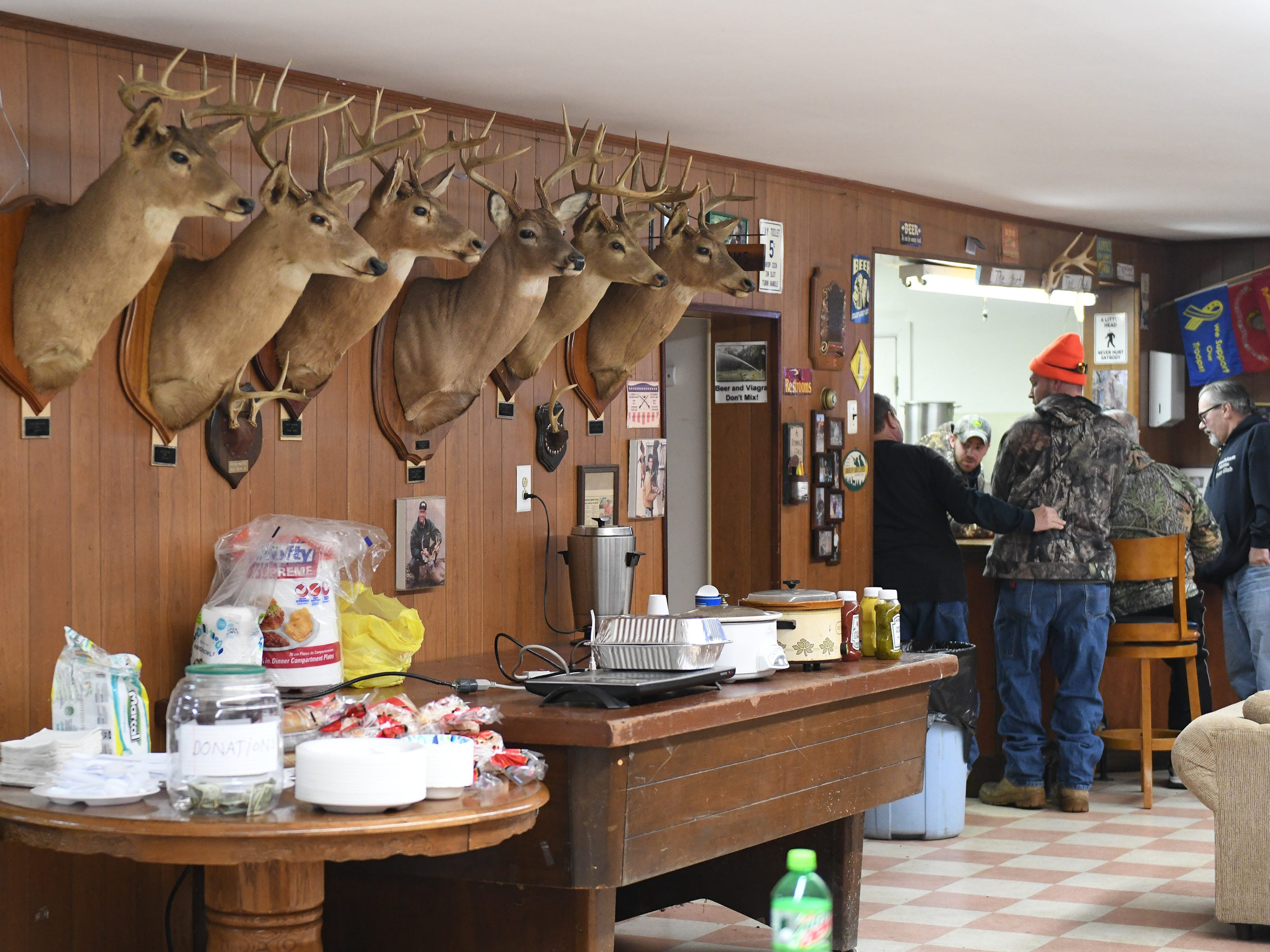 Deer mounts adorn the walls at the Inskip Antler Hunting Club in Winslow Township on Saturday, Feb. 16, 2019. The club hosted the First Annual Family Squirrel Classic while activists protested outside.