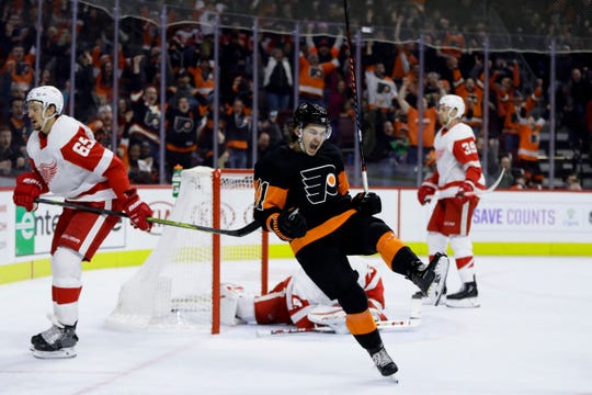 Travis Konecny scored in overtime to give the Flyers a win after they blew a four-goal lead in the third period against the Detroit Red Wings.
