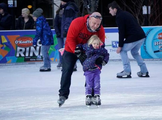 Lou Coduti teaches his daughter Mens, age 4, to skate, Fountain Square Skating Rink, Feb. 19, 2019.