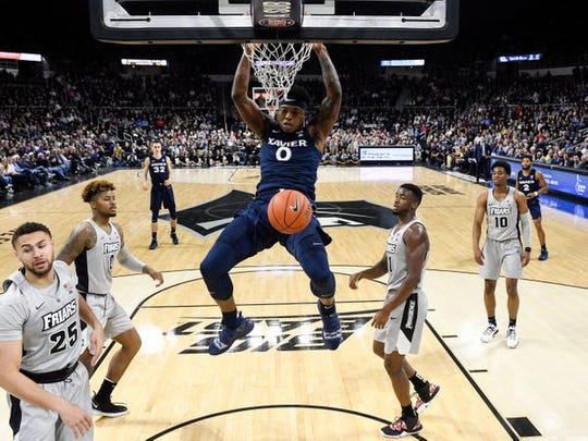 Xavier Musketeers forward Tyrique Jones dunks and scores against the Providence Friars during the first half Saturday at the Dunkin Donuts Center.