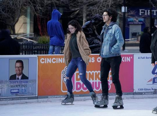Olivia McGeorge and Hoyt Hallford on a first date at the Fountain Square Skating Rink, Feb. 19, 2019.