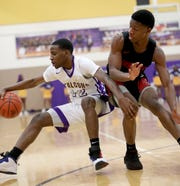 Aiken guard Jakada Stone (12) is defended by Hughes guard AB Harouna  during their basketball game , Friday, Feb. 15, 2019. Aiken beat Hughes 91-80 for three-way tie of the Cincinnati Metropolitan Athletic Conference title.