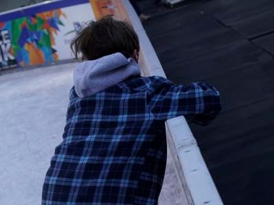 A young skater braces himself for another attempt on the ice at the Fountain Square Skating Rink, Feb. 19, 2019.