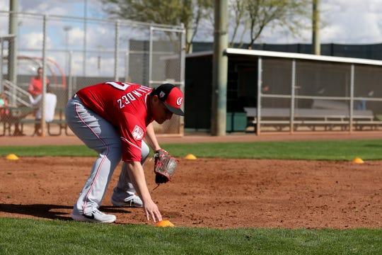 Cincinnati Reds relief pitcher David Hernandez (37) participates in fielding drills, Saturday, Feb. 16, 2019, at the Cincinnati Reds spring training facility in Goodyear, Arizona.