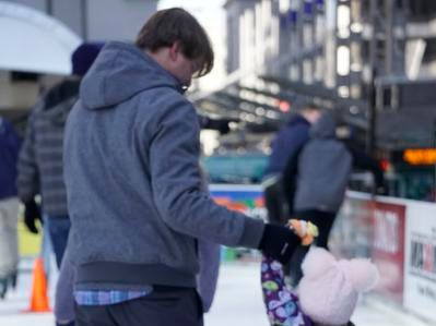 Joe Bartoszek helps his daughter, Magnolia, skate at the Fountain Square Skating Rink, Feb. 19, 2019. It was Magnolia's 3rd birthday.