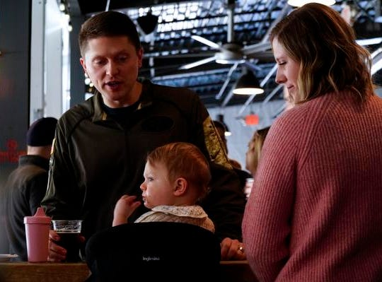 Ashley and Graham Wayner, with their 17-month-old daughter Greer, MadTree Brewing's Winter Bonanza, Feb. 19, 2019. The Wayners have frequented MadTree for 5 years, but have new appreciation for the brewery's family friendly atmosphere.