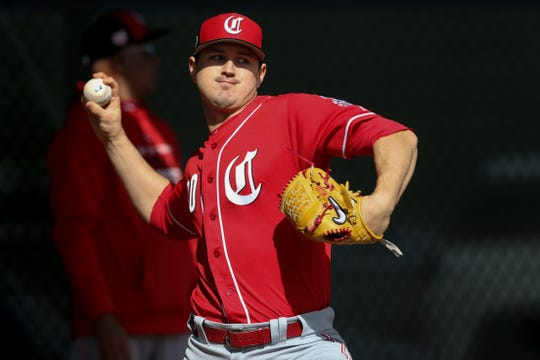Cincinnati Reds starting pitcher Tyler Mahle (30) throws during a bullpen session, Saturday, Feb. 16, 2019, at the Cincinnati Reds spring training facility in Goodyear, Arizona.