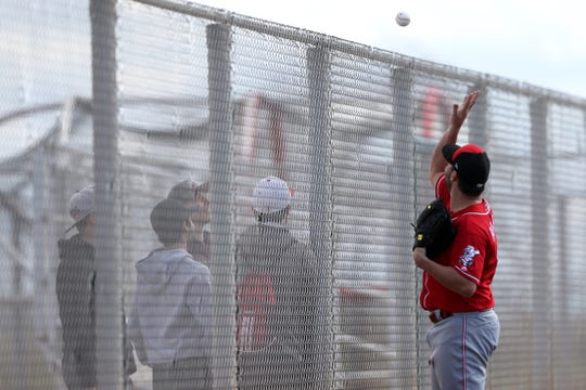 Cincinnati Reds pitcher Tanner Roark (35) tosses a baseball to a fan, Saturday, Feb. 16, 2019, at the Cincinnati Reds spring training facility in Goodyear, Arizona.