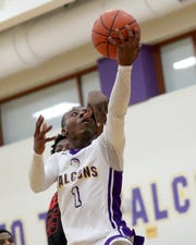 Aiken guard D'Arris Dean drives to the basket  during their game against Hughes, Friday, Feb. 15, 2019. Aiken beat Hughes 91-80 for three-way tie of the Cincinnati Metropolitan Athletic Conference title.