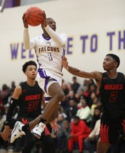 Aiken  guard D'Arris Dean drives to the basket against Hughes guard  AB Harouna (2) during their game , Friday, Feb. 15, 2019. Aiken beat Hughes 91-80 for three-way tie of the Cincinnati Metropolitan Athletic Conference title.