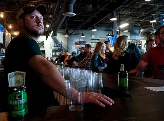 Eric Frimming of MadTree Brewing pauses between pours at Winter Bonanza, Feb. 19, 2019. Two hours into the event, the brewery had already poured approximately 2,500 beers.
