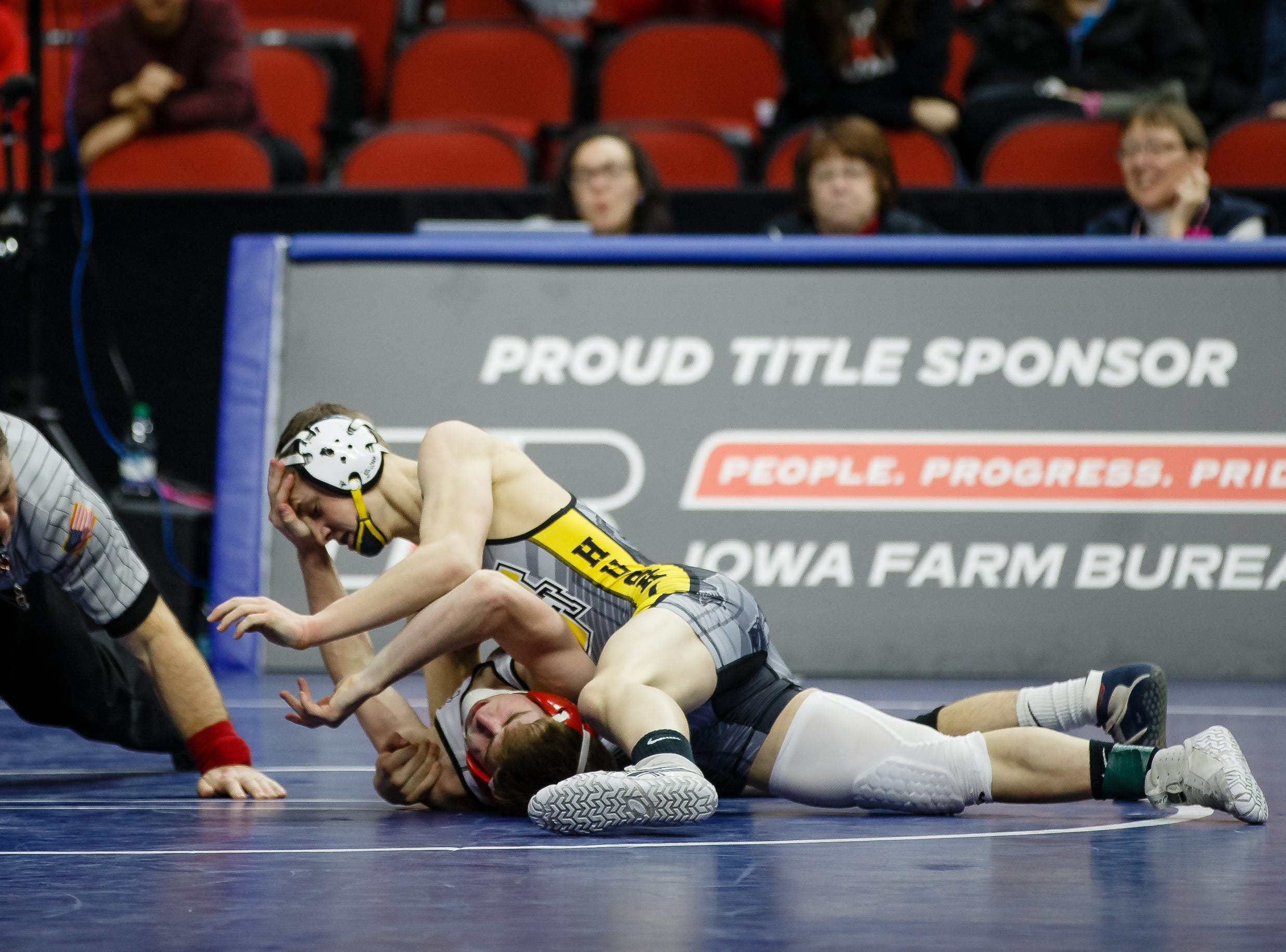 Bryce Hatten of Winterset wrestles Mason Cleveland of NH/TV during their class 2A 126 pound state championship semi-final match on Friday, Feb. 15, 2019 in Des Moines. Hatten moves onto the finals with a 16-6 major decision.