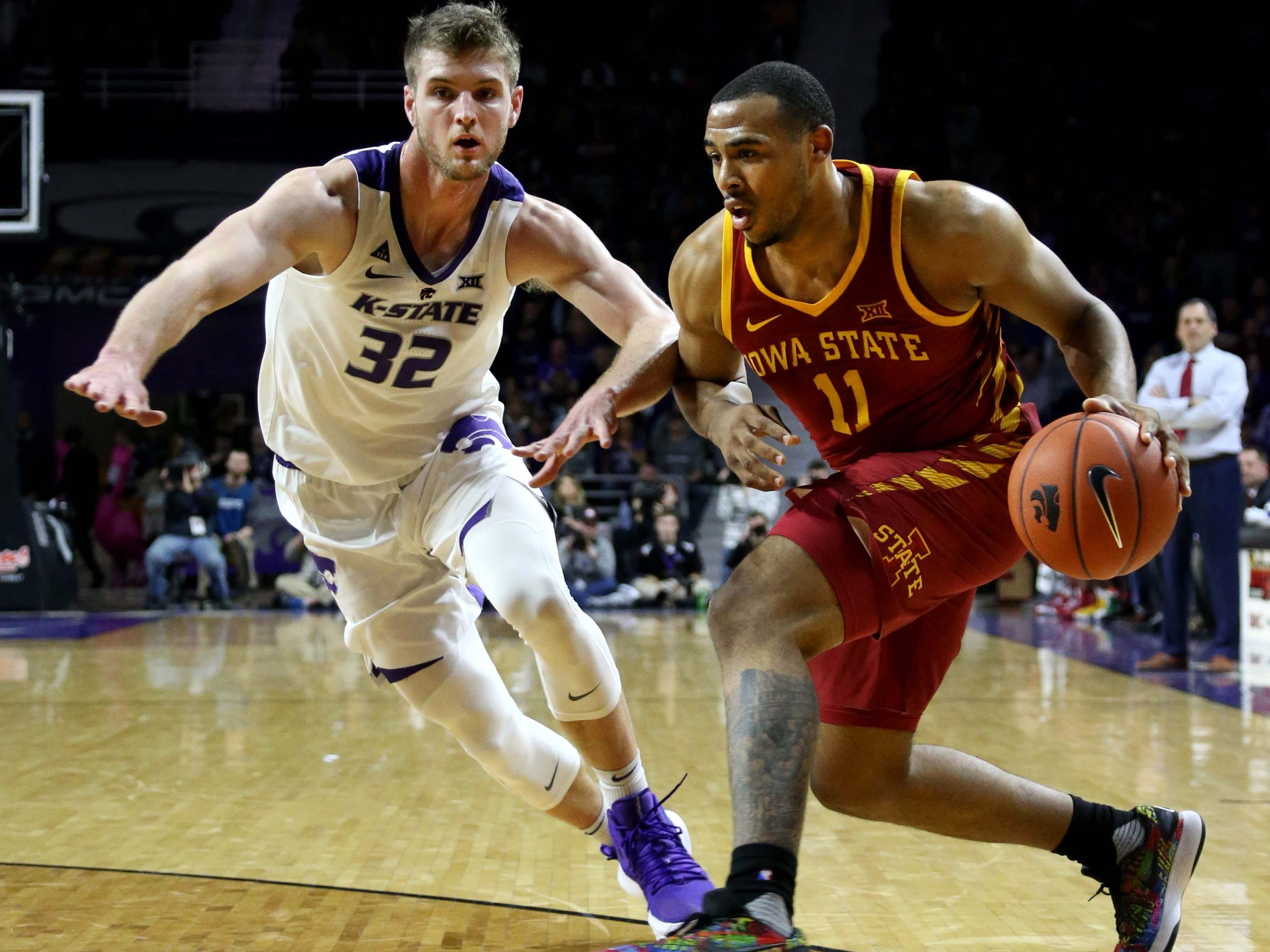 Feb 16, 2019; Manhattan, KS, USA; Iowa State Cyclones guard Talen Horton-Tucker (11) is guarded by Kansas State Wildcats forward Dean Wade (32) during the first half at Bramlage Coliseum.