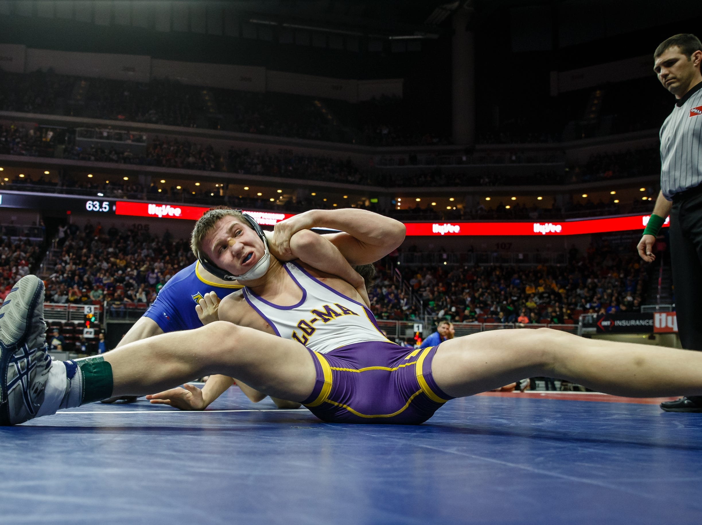 Briar Reisz of Logan-Magnolia wrestles Cole Cassady of Martensdale, St. Mary's during their class 1A 126 pound state championship semi-final match on Friday, Feb. 15, 2019 in Des Moines. Reisz moves onto the final with a 3-1 decision.