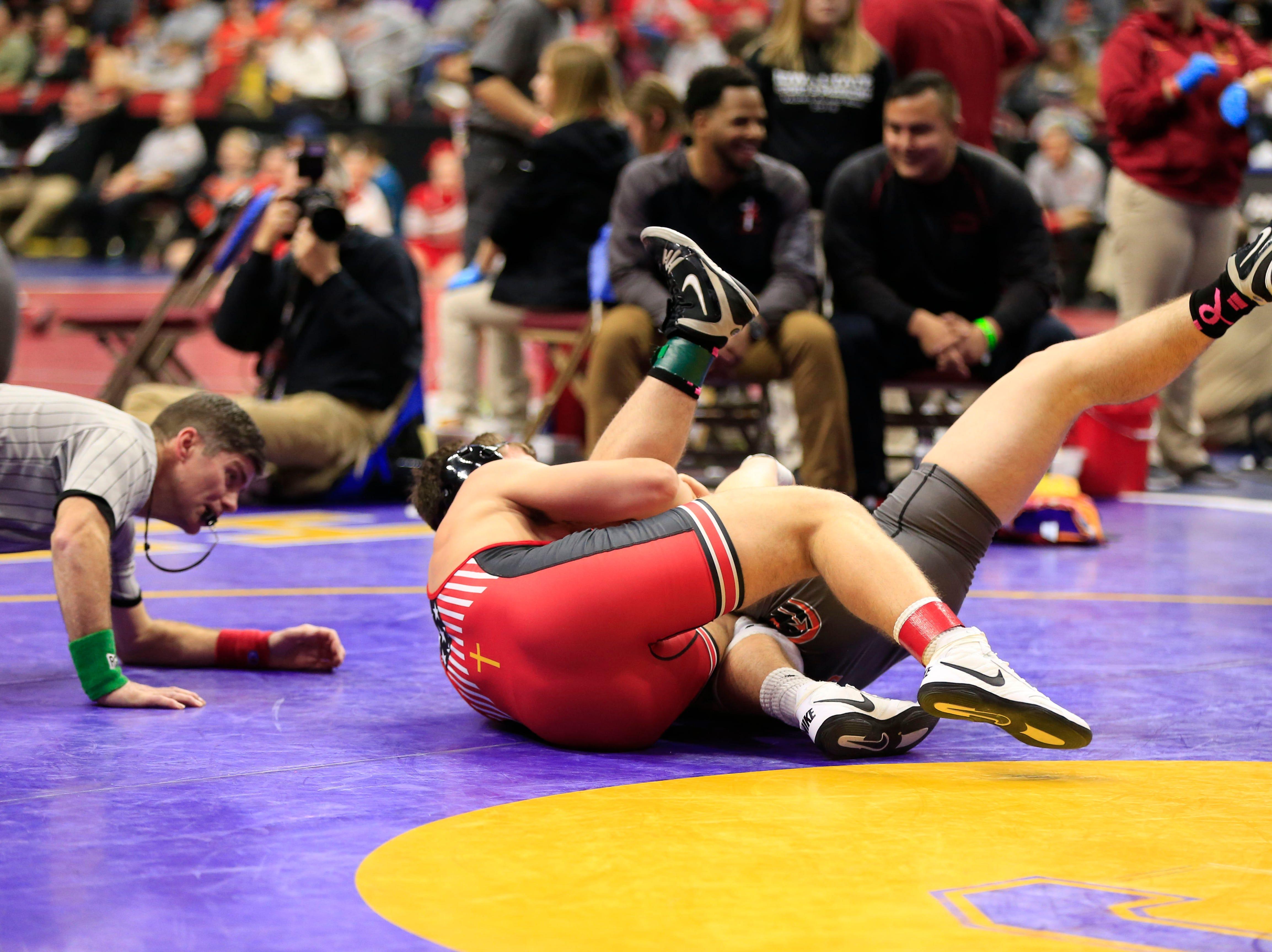 Julien Broderson of Assumption defeats Logan Escher of Washington during a 195 Lb 2A quarterfinal match at the state wrestling tournament Friday, Feb. 15, 2019.