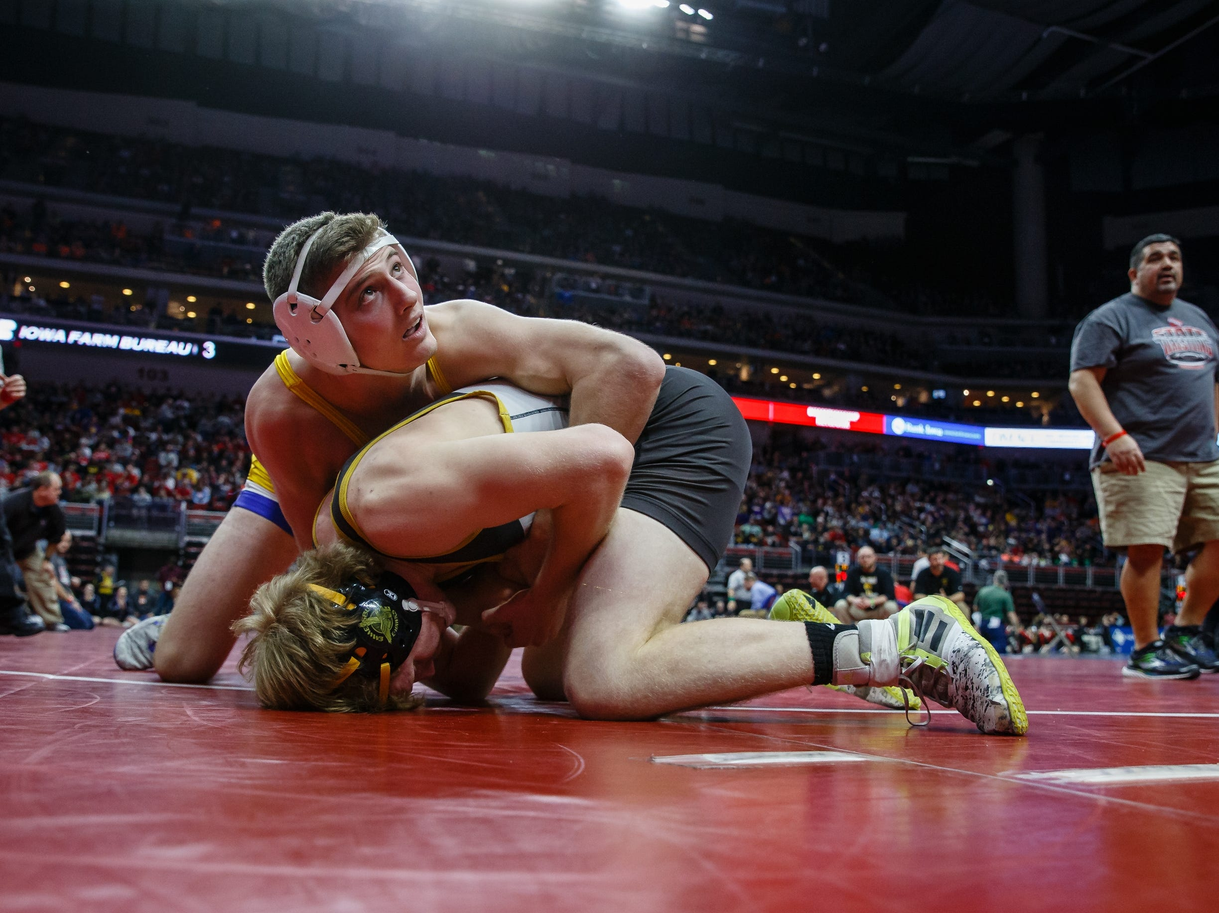 Mason Griffin of Emmetsburg wrestles Carson Tenold of Don Bosco during their class 1A 160 pound state championship semi-final match on Friday, Feb. 15, 2019 in Des Moines. Tenold moves onto the finals with a 10-5 decision.