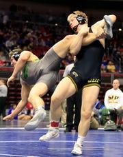 Gabe Christenson of Southeast Polk defeats Cade Parker of Cedar Rapids Kennedyduring a 195 Lb 3A semifinal match at the state wrestling tournament Friday, Feb. 15, 2019.