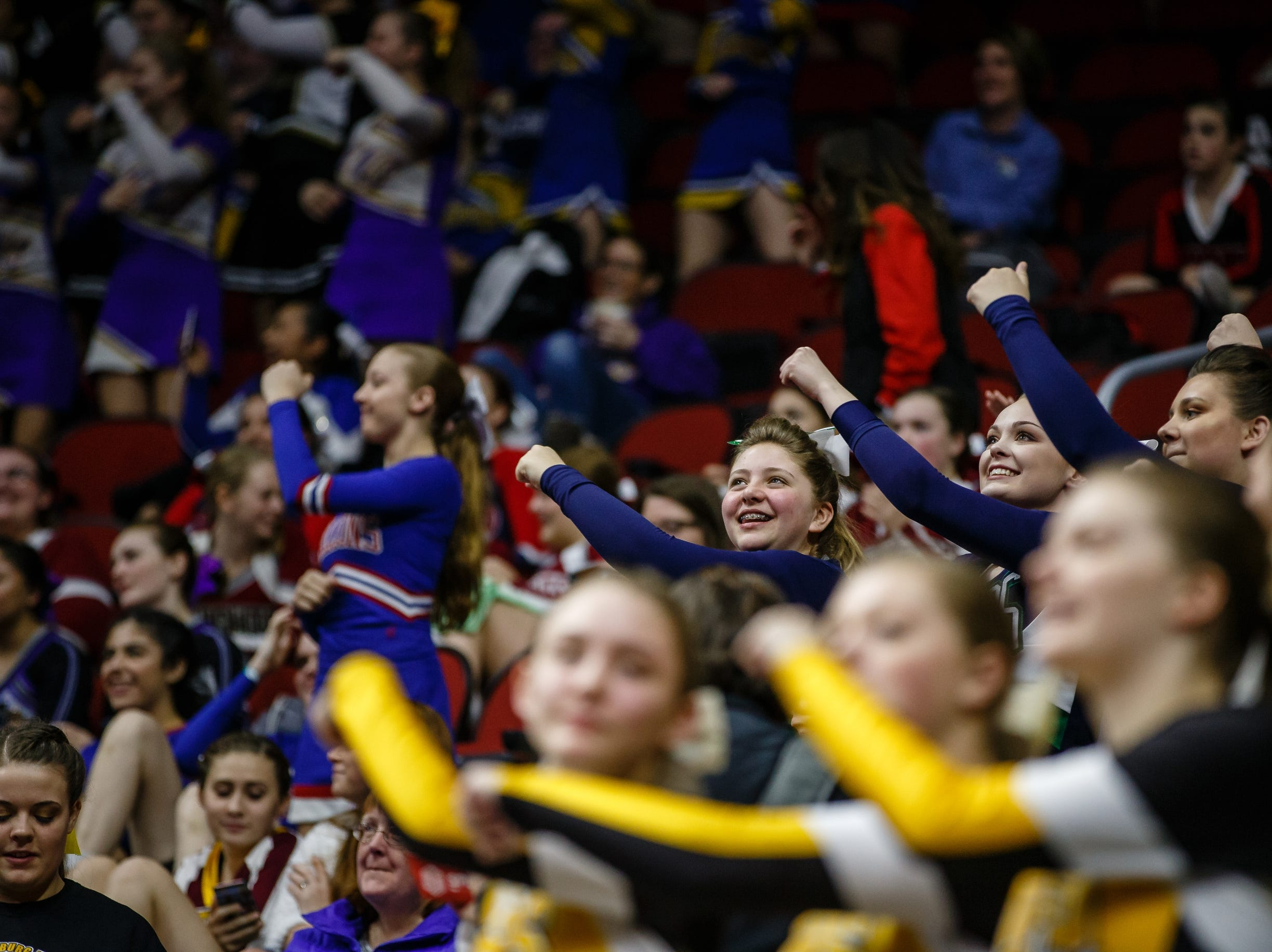 Cheerleaders dance in the stands before the 1A state championship semi-final round on Friday, Feb. 15, 2019 in Des Moines.