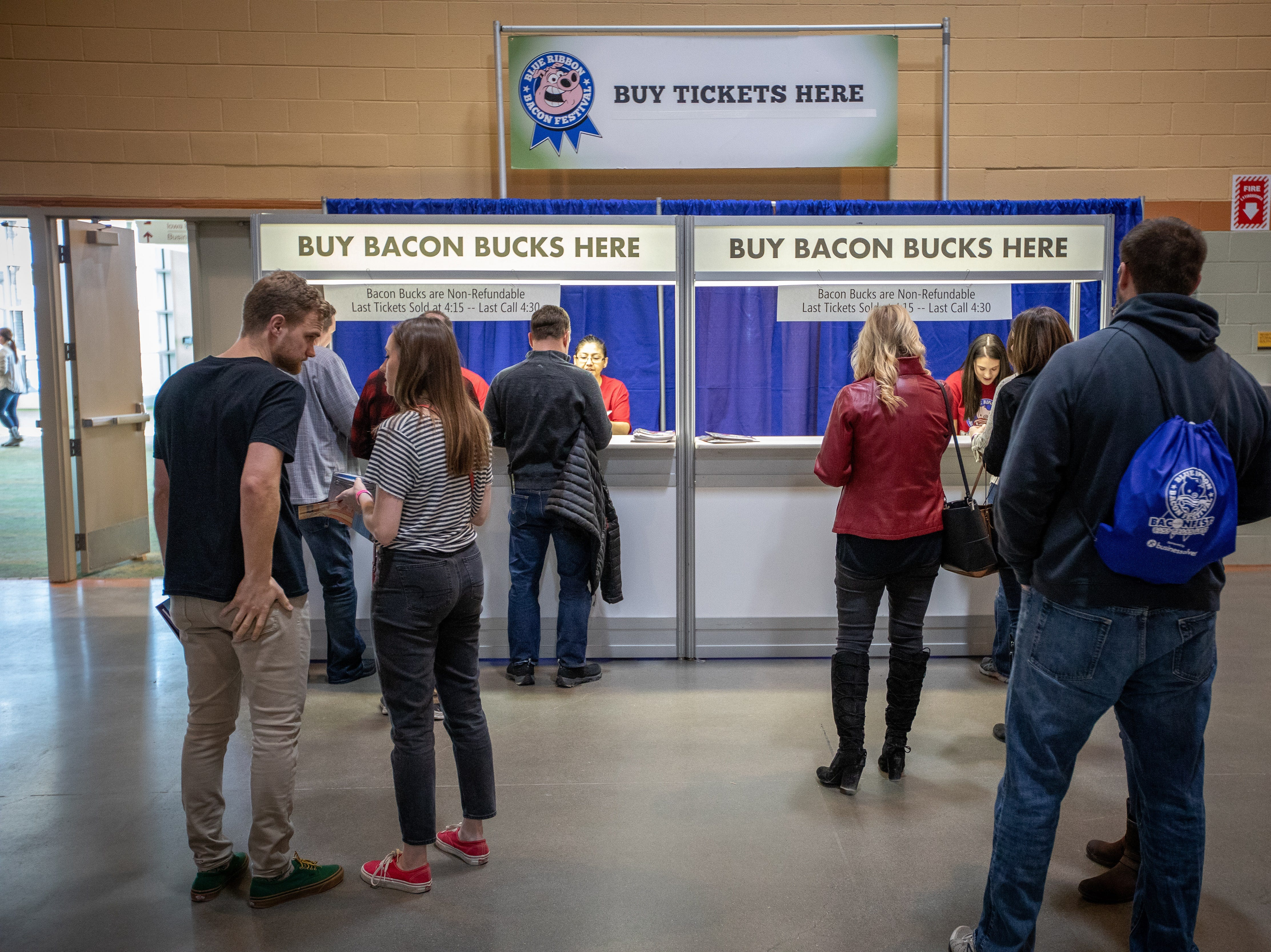 Patrons line up to buy Bacon Bucks during the Bacon Fest at Hy-Vee Hall on Feb. 16, 2019 in Des Moines, Iowa.