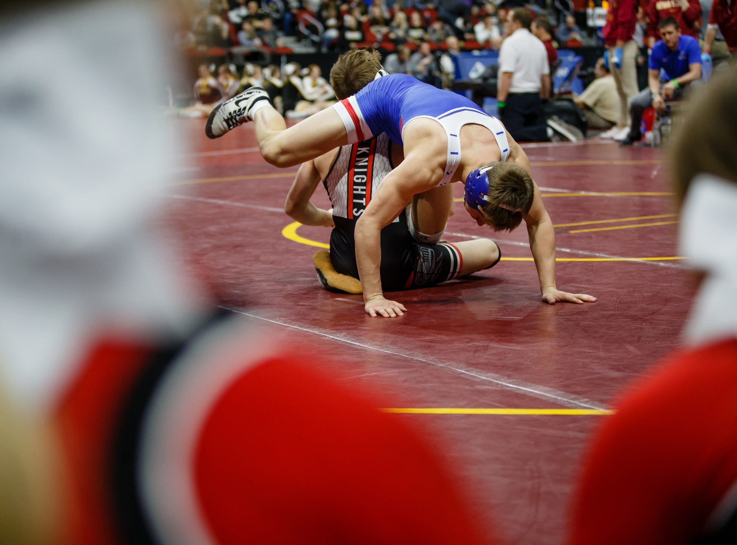 Kaleb Olejniczak of Perry wrestles Jack Thomsen of Union, Jr during their class 2A 138 pound state championship semi-final match on Friday, Feb. 15, 2019 in Des Moines. Thomsen moves onto the final.
