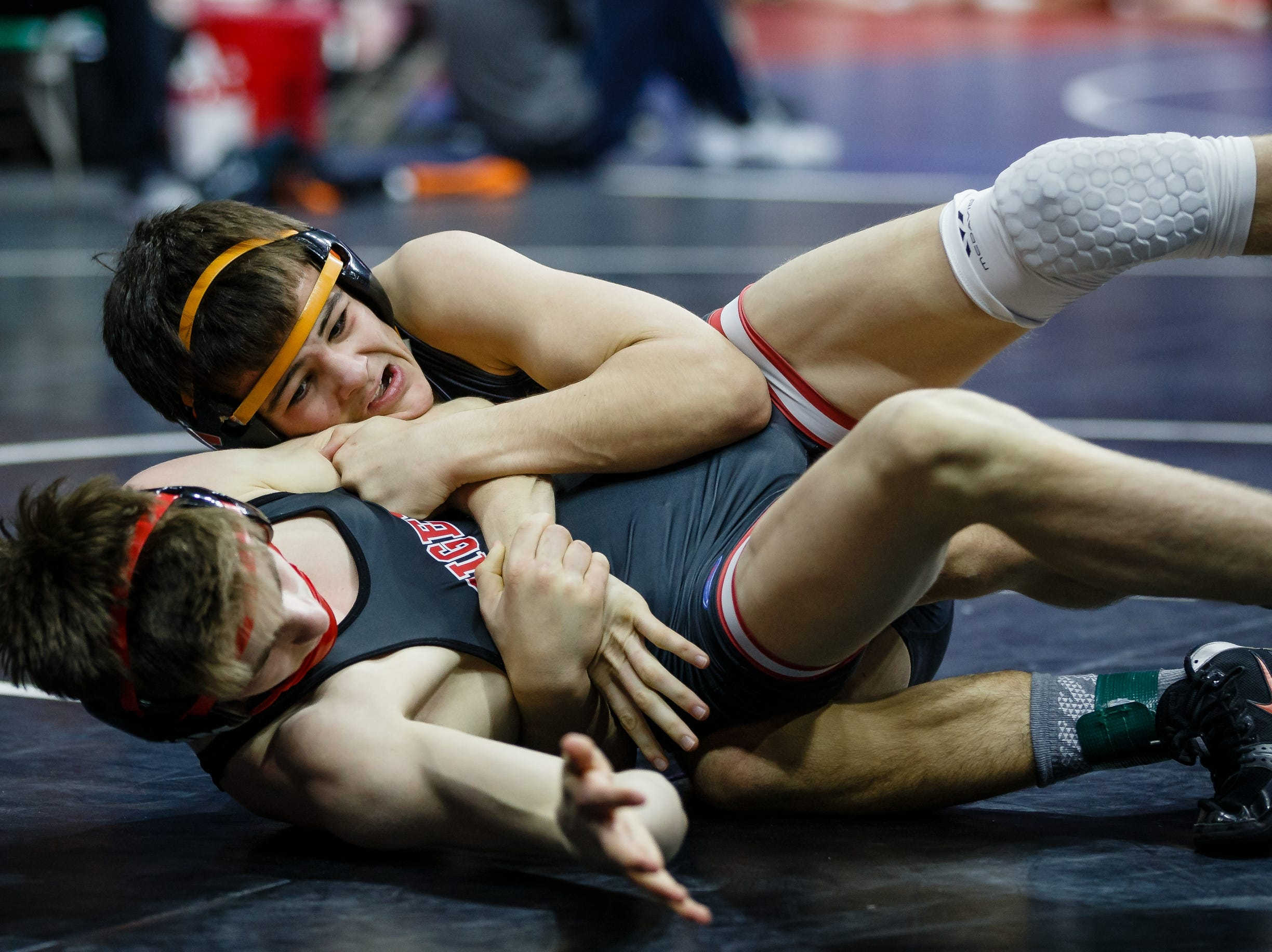 Andrew Flora of ADM wrestles Hayden Taylor of Solon during their class 2A 126 pound state championship semi-final match on Friday, Feb. 15, 2019 in Des Moines. Taylor moves onto the finals with a 15-0 tech fall.