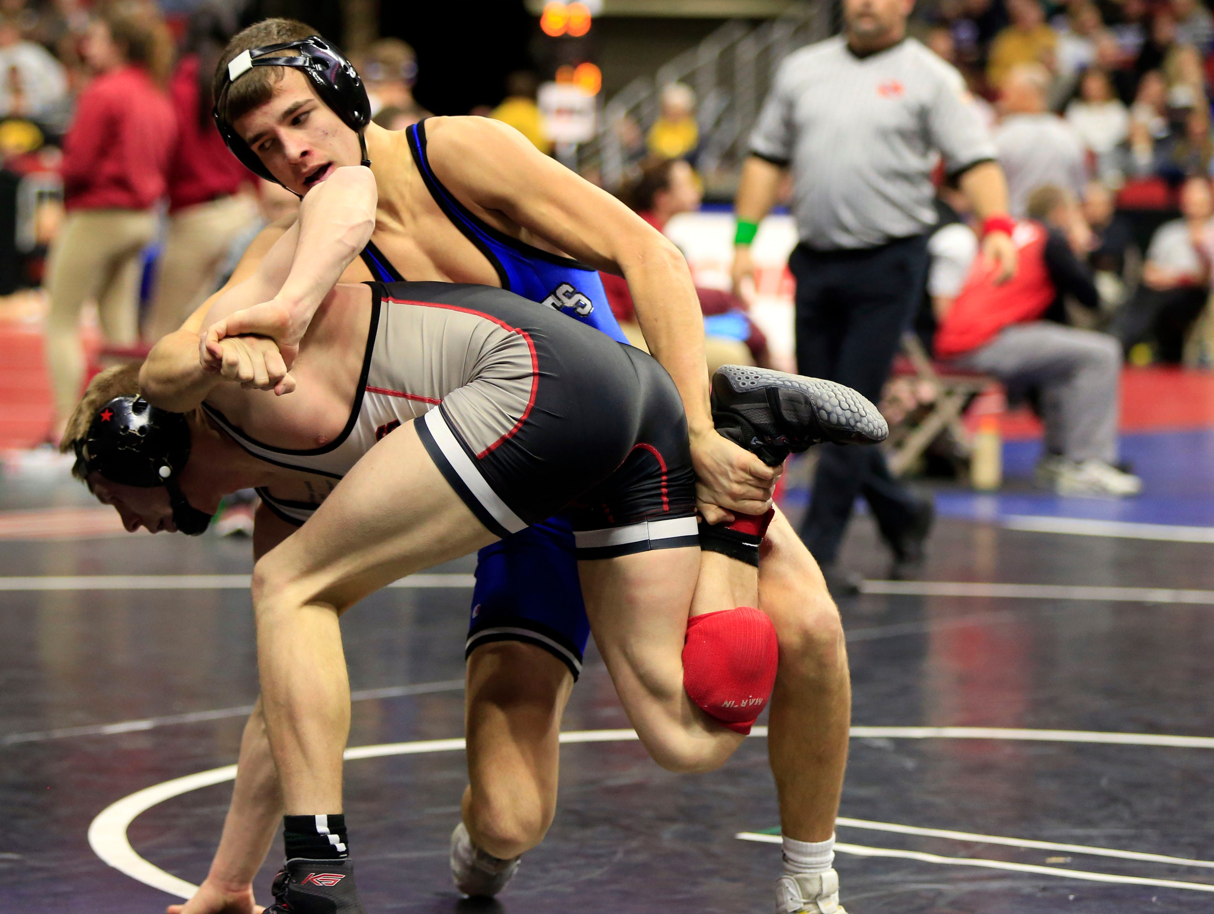 Will Esmoil of West Liberty defeats Chase Luensman of Monticello during a 145 Lb 2A quarterfinal match at the state wrestling tournament Friday, Feb. 15, 2019.
