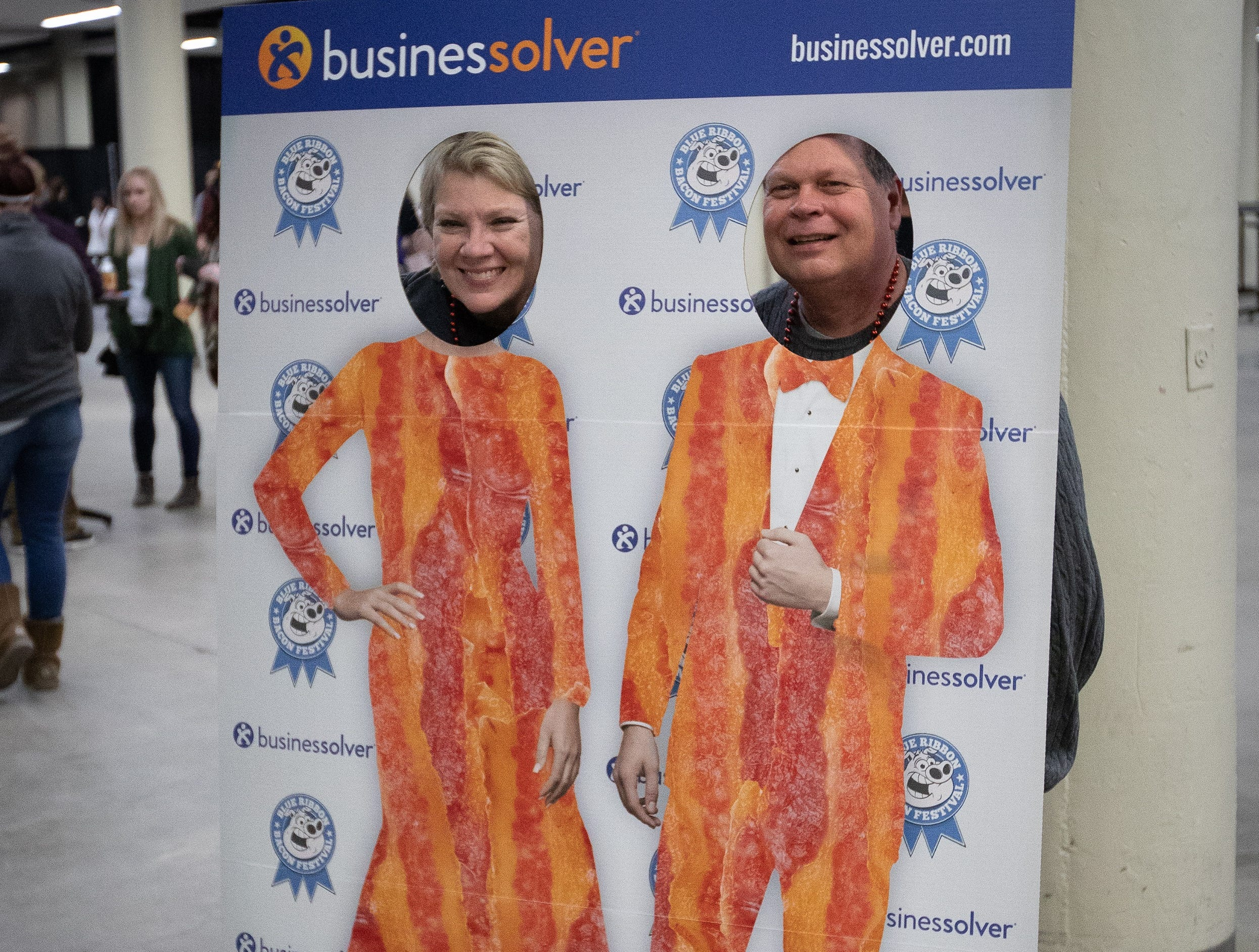 Carol and Jeff Paxhia, of Waukee, pose for a photo during the Bacon Fest at Hy-Vee Hall on Feb. 16, 2019 in Des Moines, Iowa.